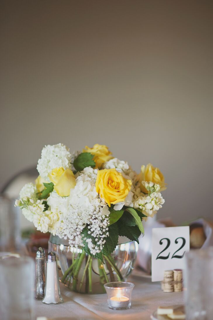 The centerpieces included white hydrangeas, yellow roses and baby's breath.