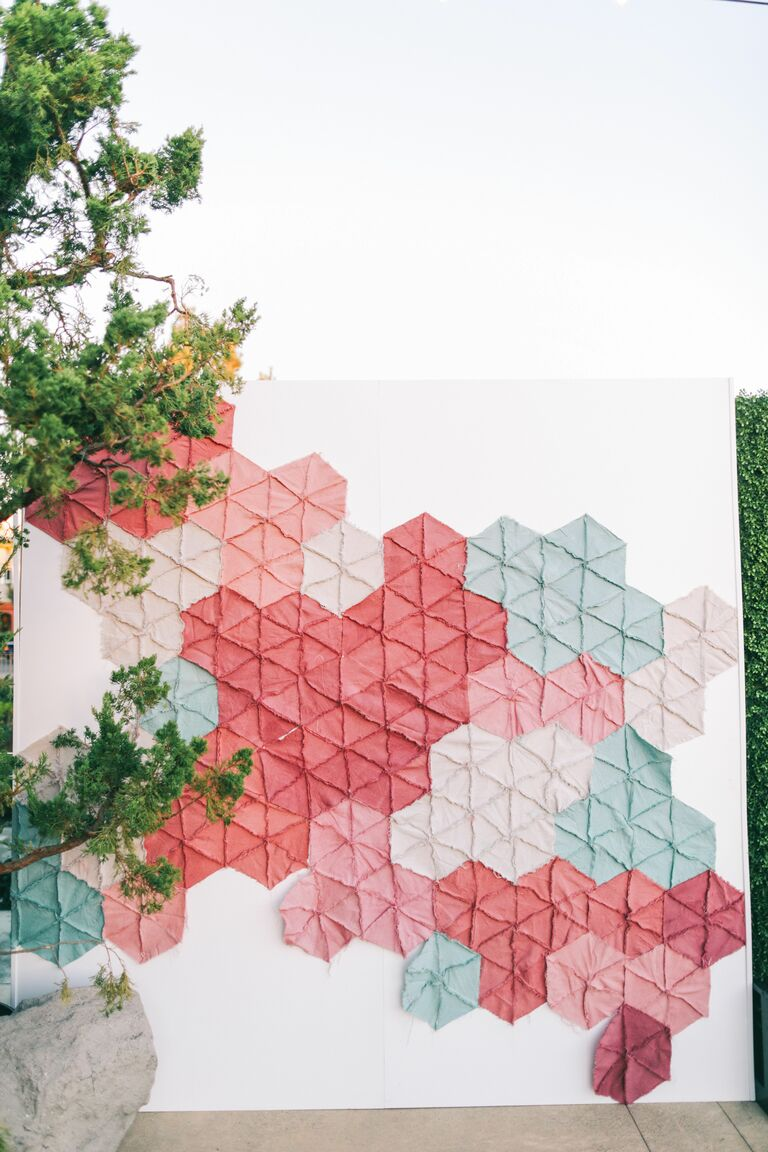 Photo booth backdrop with quilt