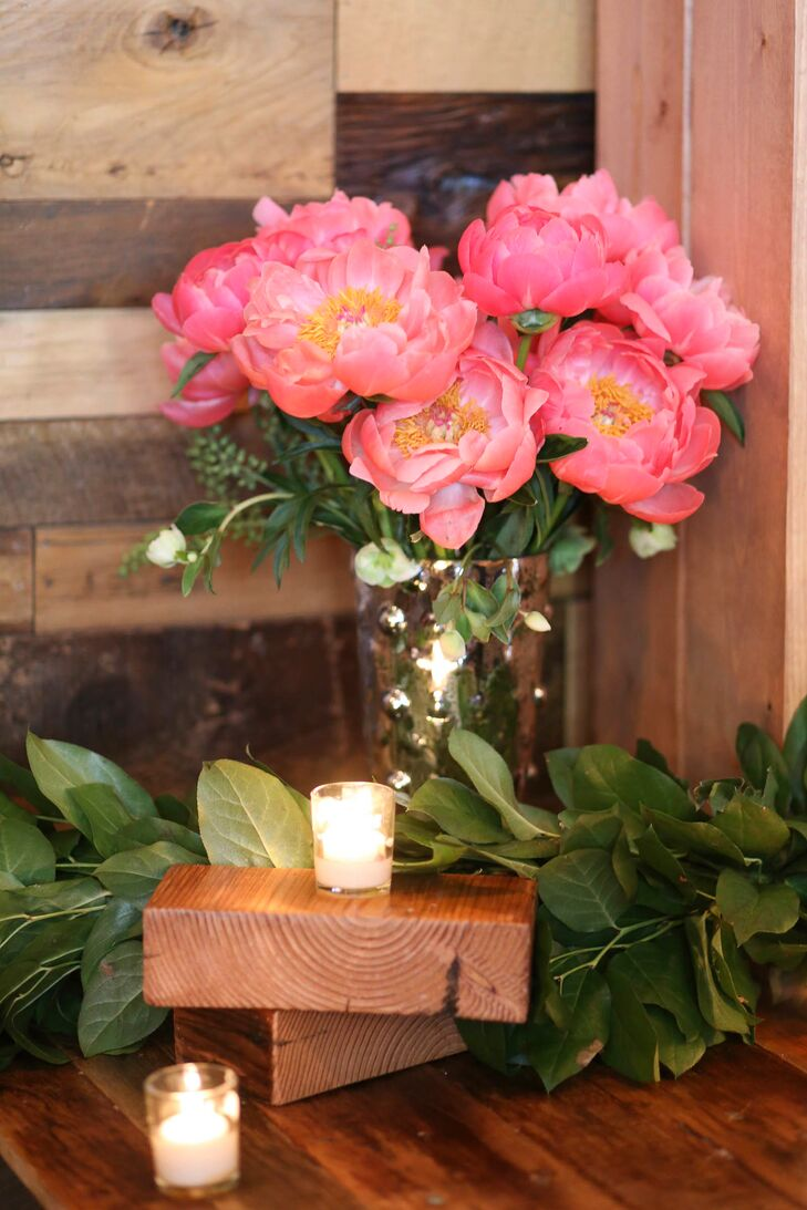 From the reception tables to Brooklyn Winery's zinc-topped bar, arrangements of peonies, roses and wildflowers in brilliant shades of pink, coral rose and cream were incorporated throughout to add a pop of color to the venue's cool rustic event spaces.