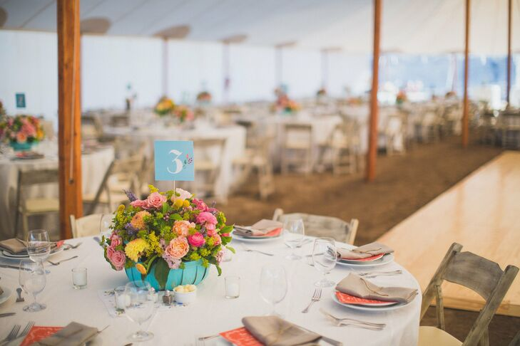 The reception took place under a large white tent. The reception had a shabby chic feel with antiqued chairs, simple place settings with neutral linens and colorful handkerchiefs.