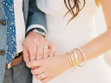 Bride with gold wedding bracelets