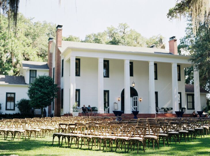 Their Christian ceremony brought out the natural theme with an understated design. About 165 Sonoma wood chairs from Terri Smith Details filled the lawn at Southwood House as the main decor. Each one matched the surrounding oak trees and provided the more relaxed atmosphere Laurie and Brian wanted for their guests.