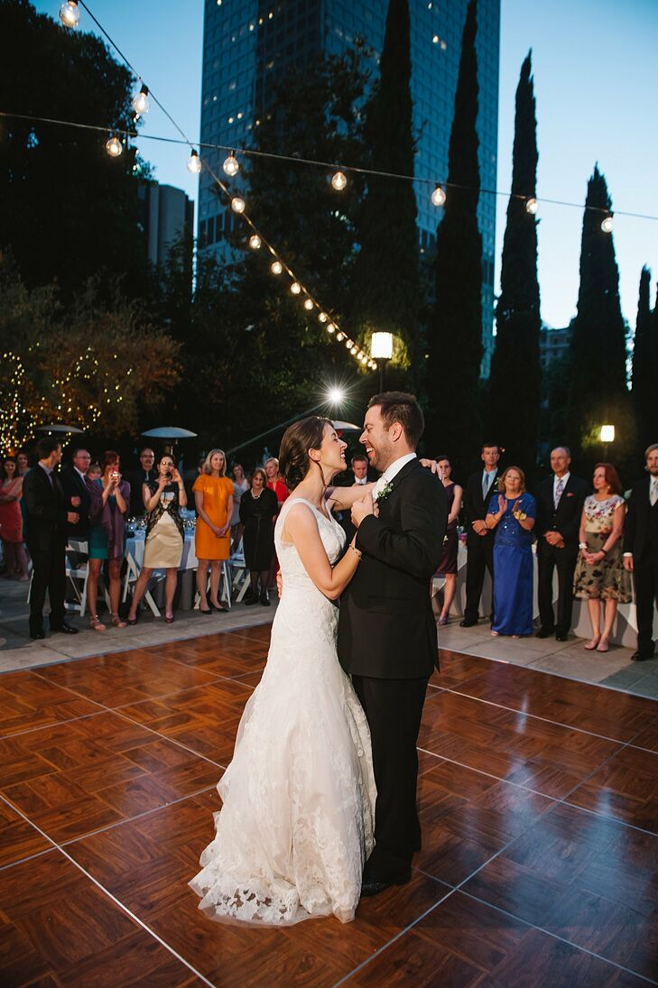 Adrienne and Cameron were all smiles during their first dance outdoors at Cafe Pinot in Los Angeles.