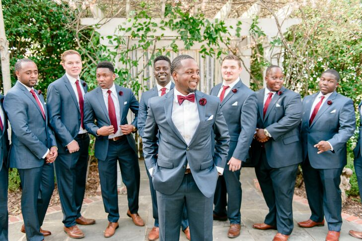 Timothy's nine groomsmen sported navy blue suits that they embellished with Marsala red ties and floral lapel pins. The couple's 4-year-old son was their best man.