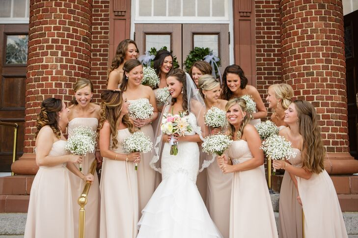 "First and foremost, Erin wanted her bridesmaid dresses to be affordable. ""I found the winner in a romantic ice pink Kanali K dress,"" says Erin. ""It was subtle, yet beautiful, and everyone looked great in them!"""