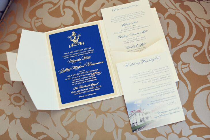 The wedding invitations were printed in gold foil on French blue satin cardstock and displayed in champagne trifold envelopes.