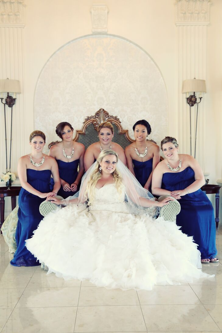 The bridesmaids wore the same crinkle chiffon, empire-waist, floor-length dress from Amsale, in French blue.