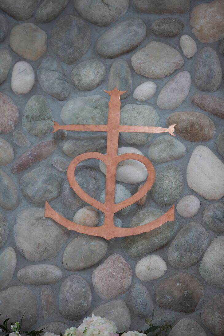 Monika and Jeffrey had a custom copper camargue cross—a symbol of faith hope and love —made to hang above the altar space for their ceremony.  It hangs in their home today.