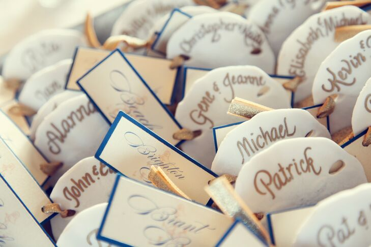 Guests found their seating assignments affixed to calligraphed sand dollars which doubled as Christmas ornaments.