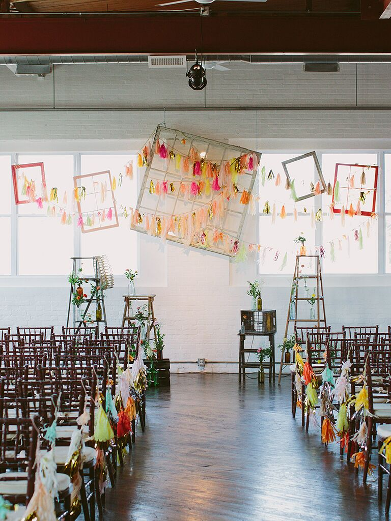 Tassel-covered industrial wedding ceremony space