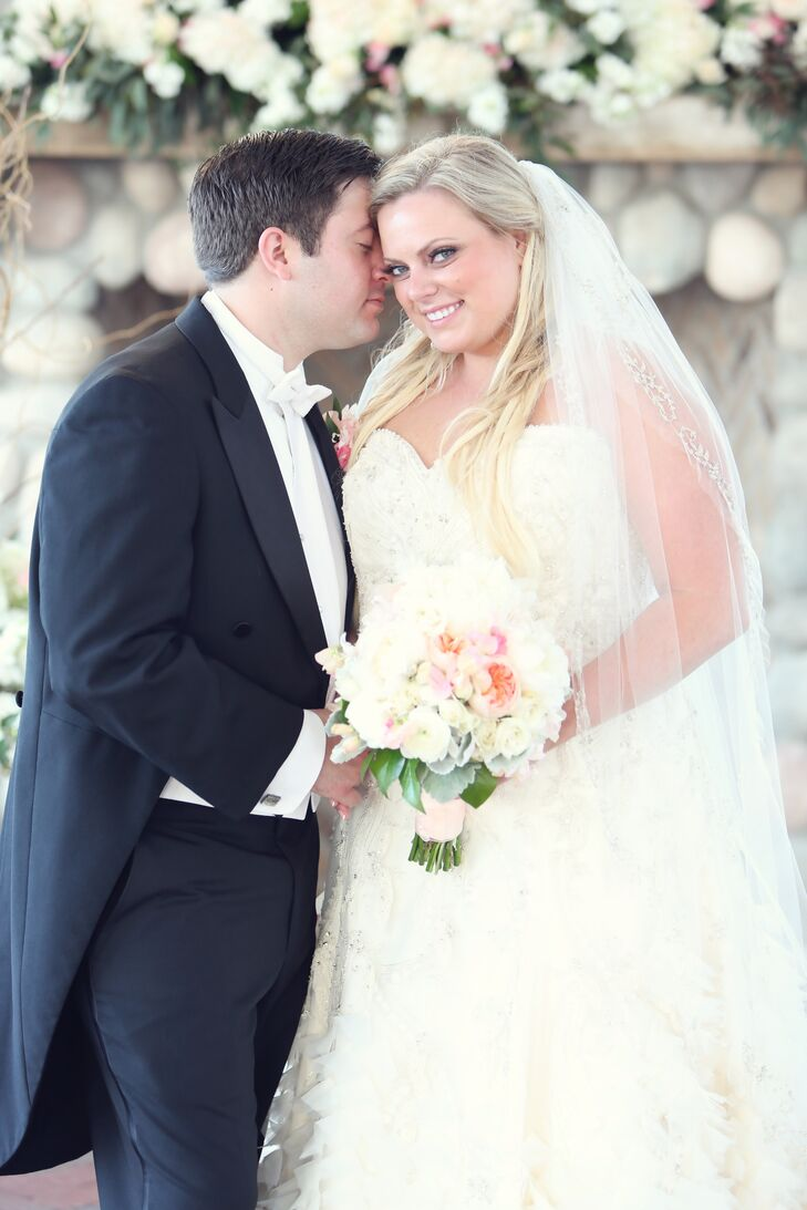 Monika wore a two-tier wedding veil with a hand-beaded trim.