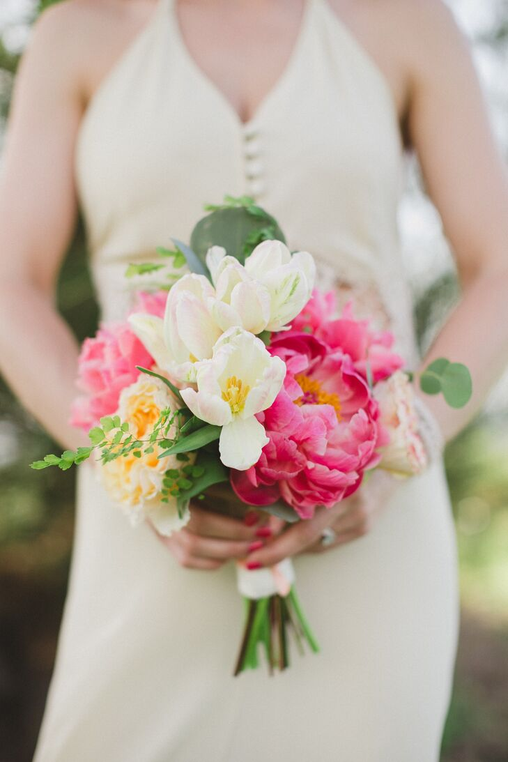 Tara's bridesmaid's bouquet had a similar vibrant, full feel, filled with pink peonies, ivory tulips and mixed greenery.