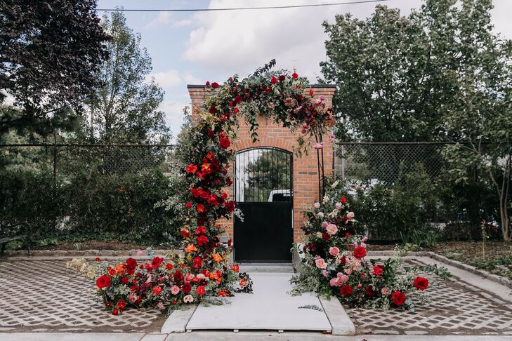 Dramatic Red Ceremony Arch at New Liberty Distillery in Philadelphia
