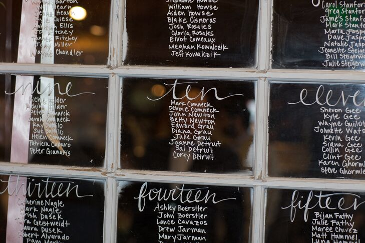 Instead of traditional escort cards, Madeline and Matt wrote their guests' names onto a white vintage window frame and displayed it at the reception entrance.