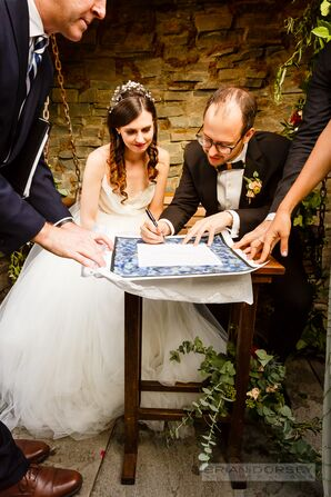 Boho Couple Signing the Ketubah
