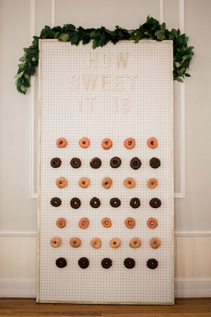 """""""And last but absolutely not least, we had a variety of doughnuts from an awesome nearby bakery,"""" the bride says. """"I loved this dessert the most."""" Mary's dad crafted a doughnut wall out of pegboard and wooden letters that read """"How Sweet It Is."""""""