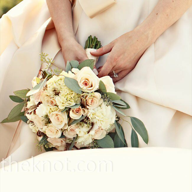 """""""I wanted a bouquet that would complement the several shades of ivory and champagne in my dress,"""" Brittany says. She chose champagne roses, ivory hydrangeas and eucalyptus."""