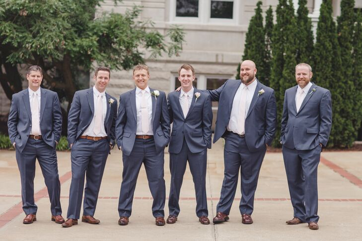 The groom and groomsmen wore postal blue suits.