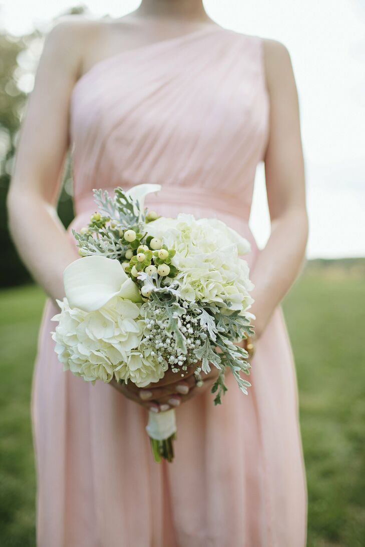 Each bridesmaid carried a green and white arrangement of hydrangeas, hypericum berries, calla lilies and dusty miller.