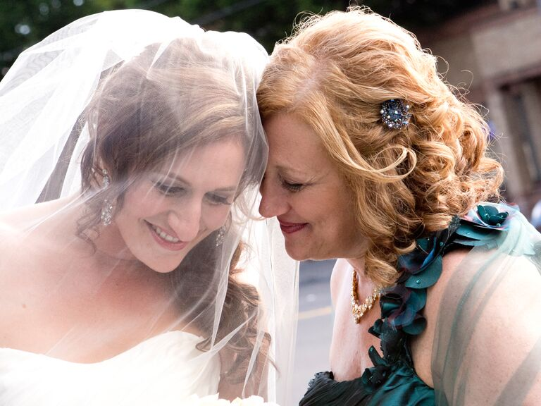 Bride and mother of the bride on wedding day