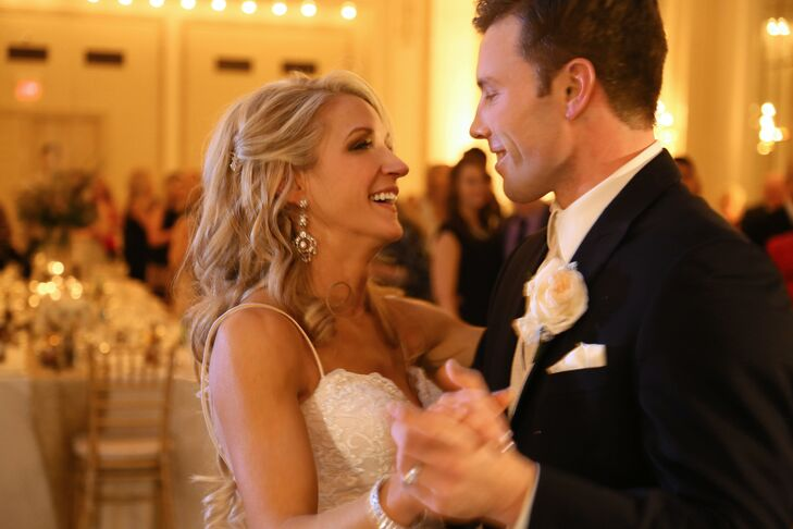 Lisa and Mark shared their first dance as a married couple at the ballroom reception inside The Westin Columbus in Columbus, Ohio. Lisa had her hair down with one side partially pinned back for the day of the wedding, which showed off her dangling silver earrings accented with crystals.