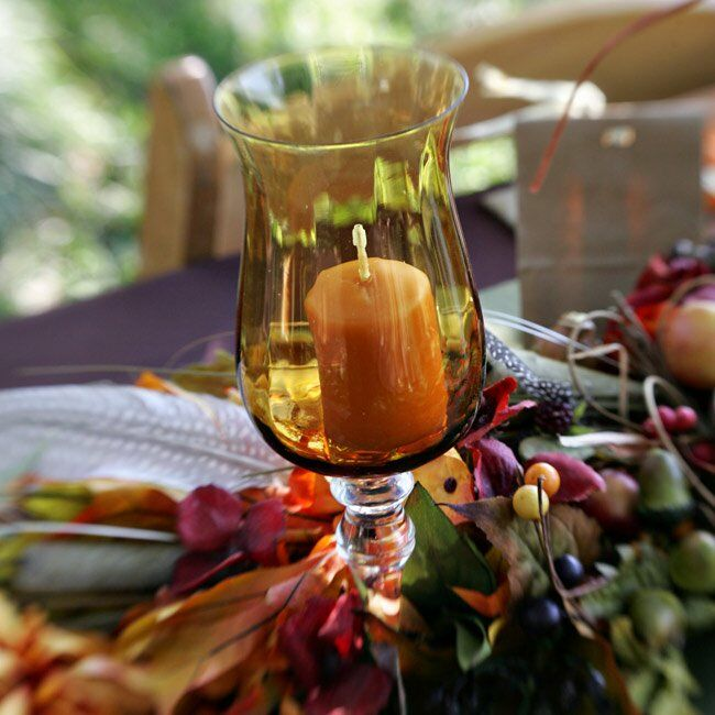 To ensure there was enough light at each table, Tatiana tucked green- and amber-colored candle holders into each table arrangement.