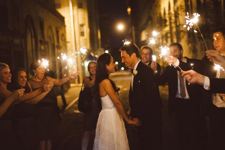 The bride and groom's families and friends surprised them with an exit illuminated by sparklers.