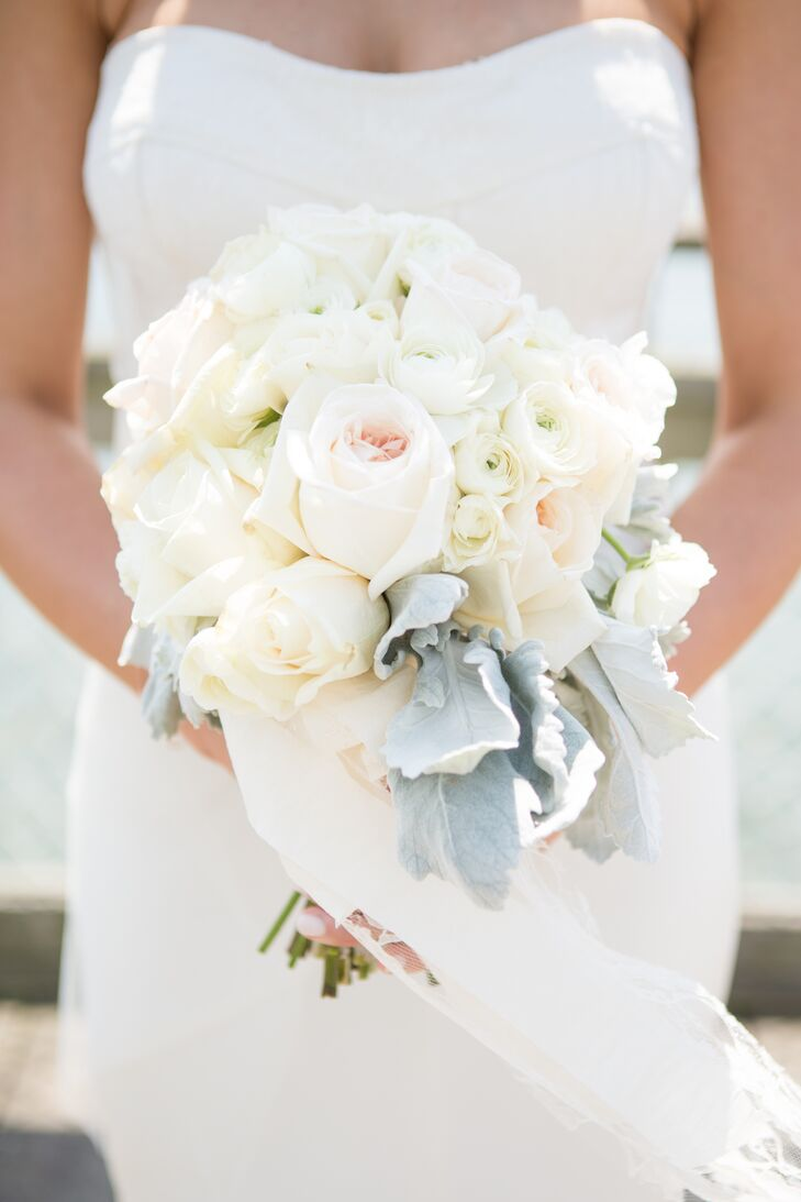 Khrysty chose light pink, peach, and ivory roses of different sizes for her bouquet to complement the bridesmaid dresses and groomsmen's ties.