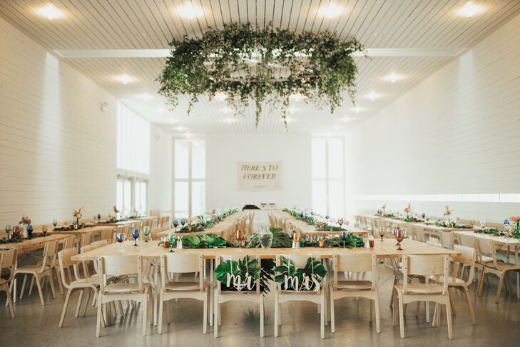 At the on-site reception hall, florist Petal Pushers crafted a hanging green garland to add an organic element to the sleek, modern space.