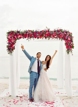 Beachfront Wedding Chuppah Decorated With Bold Blooms
