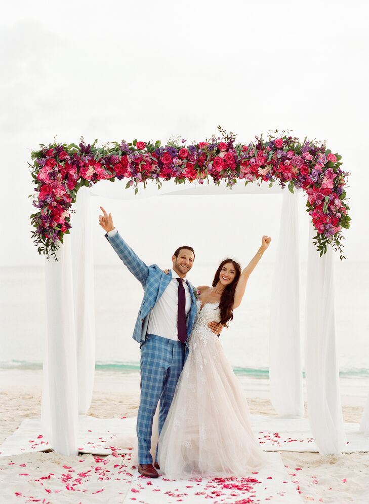 Jade Perkins and Adam Gordon's chic waterfront wedding in Grand Cayman was bursting with bright color and personalized touches. The couple and their g