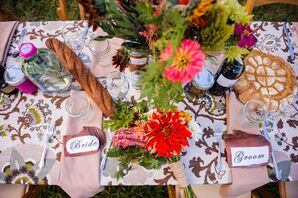 Colorfully Decorated Sweetheart Table With Signs