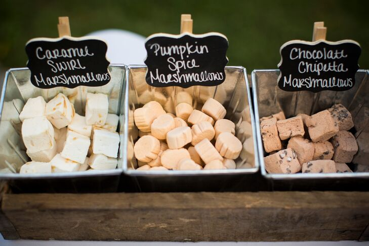 An assortment of unique marshmallow flavors were in bins for guests to use while making their S'Mores. Each bin was labeled with a black chalkboard sign.