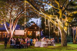 Intimate Tropical Reception with String Lights Hanging in Trees