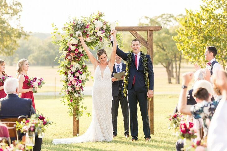 Professional volleyball players Amanda Dowdy and Brad Lawson wed at the bride's family ranch in Thrall, Texas. Their wedding combined aspects of Texas