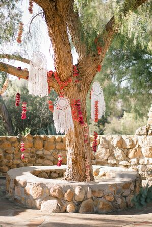 Macramé Dreamcatcher and Red Floral Ceremony Backdrop