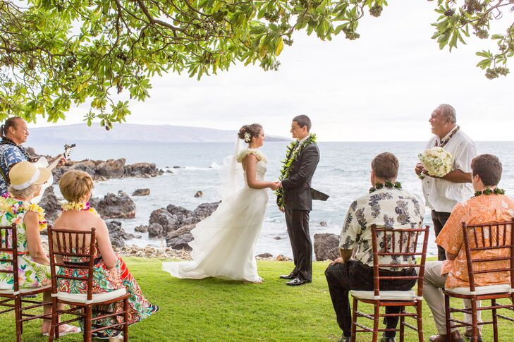 Steph and Nick stood on the edge of the lawn at Kukahiko Estate, where their ceremony took place. They had chosen Maui, Hawaii, for their honeymoon location, but then decided to combine the trip with an elopement.