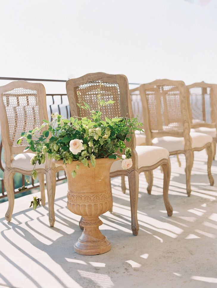 Chairs and Urn Floral Arrangement for Ceremony at Cordiano Winery in Escondido, California