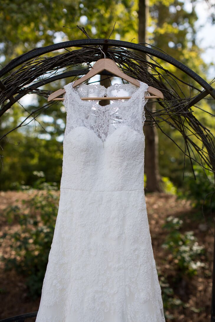 "Megan's elegant Wtoo dress was the first one she tried on. ""I wanted a lace gown to go with our rustic wedding style and loved the lace illusion neck and keyhole back of my gown,"" says Megan."