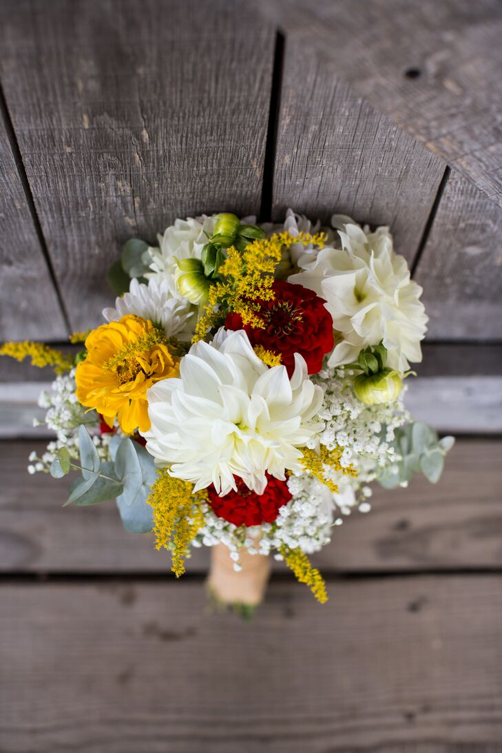 Megan and her bridesmaids put together all of the rustic bouquets and flower arrangements from fresh seasonal flowers they bought at a local farmer's market.