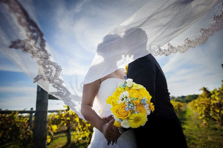 Jennifer carried a white and yellow bouquet filled with roses and gerbera daisies.