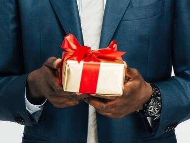 Husband holding gift