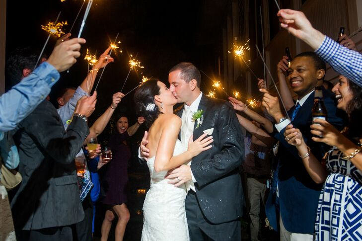 The couple left the reception surrounded by family and friends lighting sparklers in celebration.