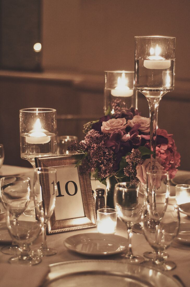 Floating candle votives added a touch of romantic elegance to the centerpiece decor.