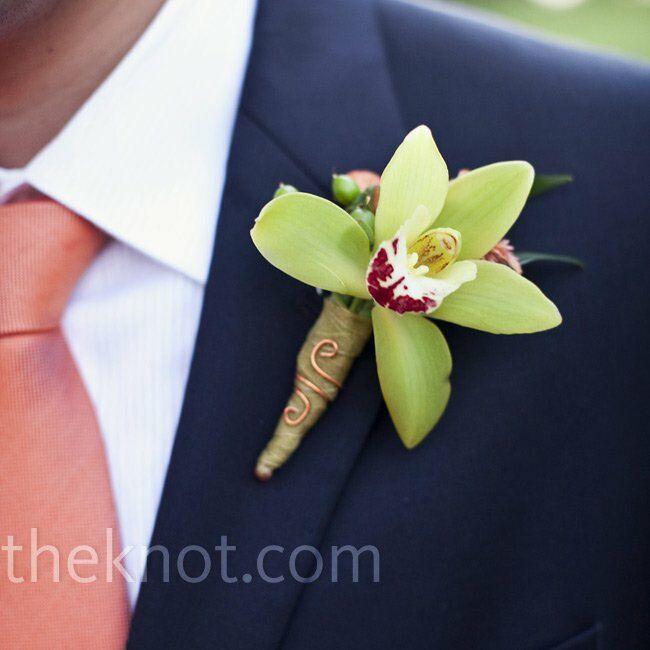 The groom wore a green mini cymbidium orchid and an orange Mokara orchid.
