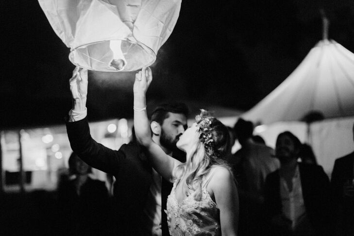 "During the reception, Isabella and Bryan invited their guests to release sky lanterns for good luck. ""It was something we did every night during a trip to Thailand,"" Isabella says. ""We channeled our intentions for this marriage and sent the lantern into the sky. It was a special moment."""