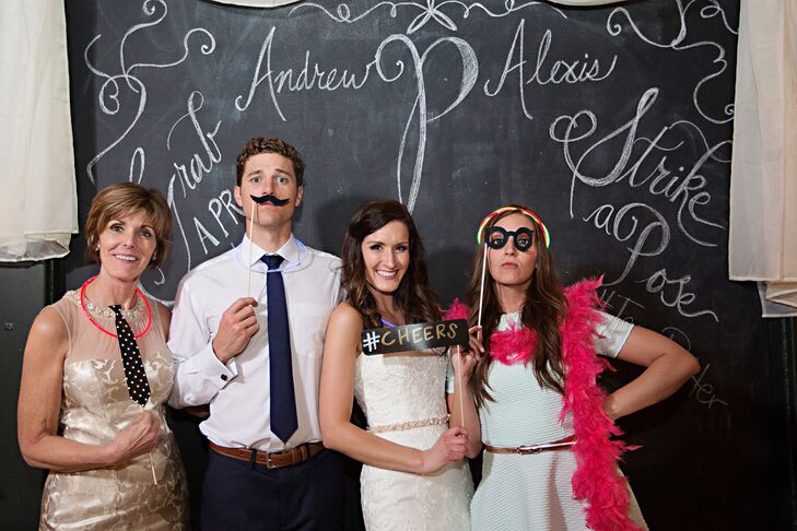 When guests needed a break from the dance floor, they headed to Alexis and Andrew's Polaroid photo booth. For their guestbook, the newlyweds' families and friends took a photo of themselves with silly props, then put it in the provided guest book, decorated the page and personalized it with a message.