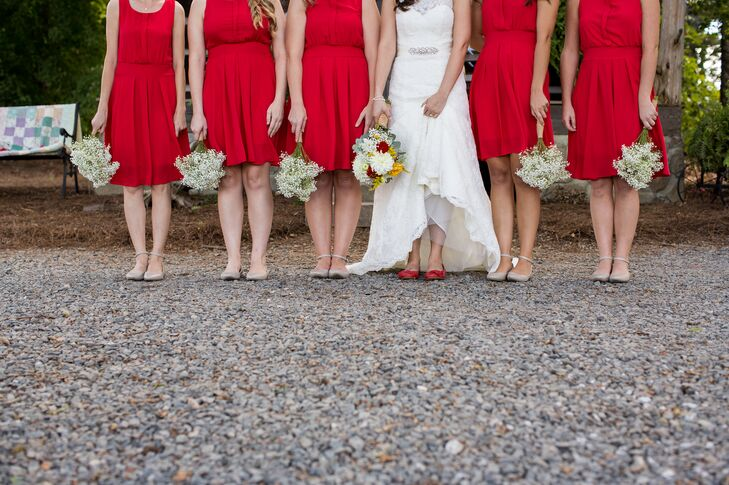 """Our main wedding color was red with hints of yellow and gray,"" says Megan. ""Red is both of our favorite color and I love how it looks with hints of yellow for a fall wedding!"""