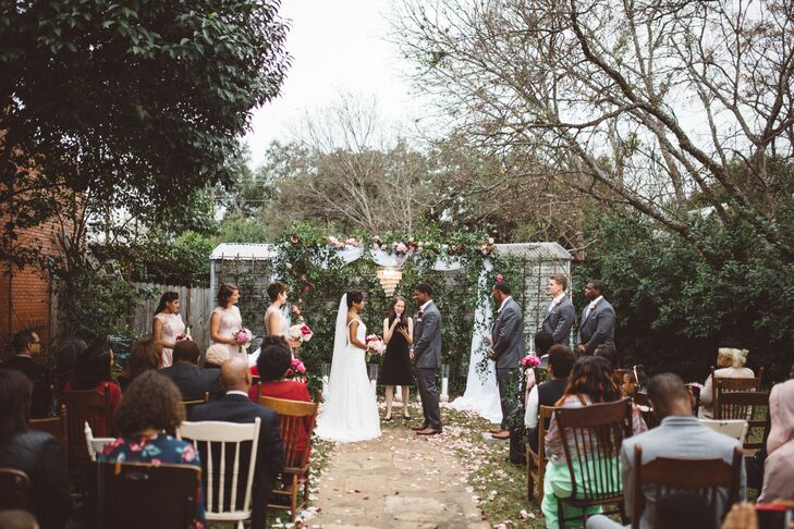 The festivities kicked off with a ceremony on the lawn, where Morgan and Stanley exchanged vows surrounded by their closest family members and friends. The pair incorporated hand-washing unity-candle ceremonies into the proceedings, as well as a memorial bench that honored their grandfathers. The intimate courtyard at The Carrington in Buda, Texas, was the perfect setting, with its lush English garden and views of the venue's historic architecture.