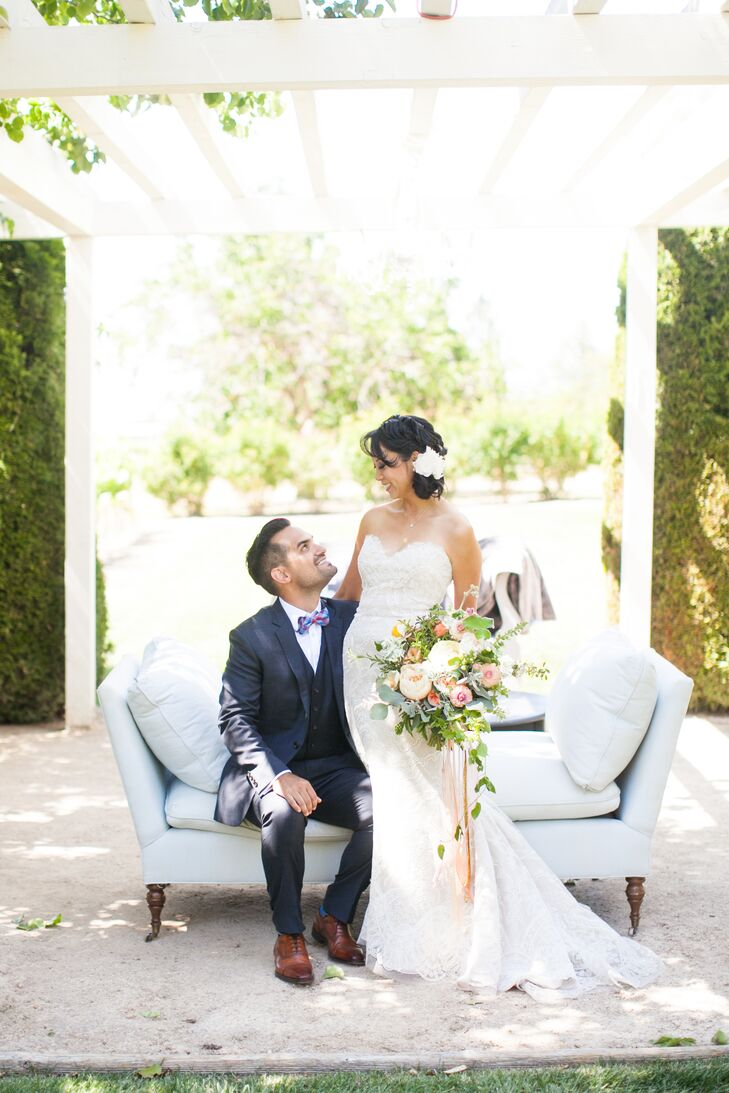 Vintage decor accented with modern flair created a dynamic contrast at this outdoor vineyard wedding, softened by a neutral color palette with wooden